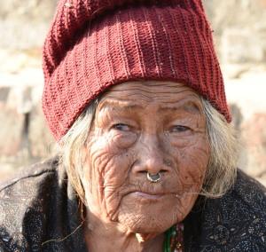 old woman at Swayambhunath Stupa